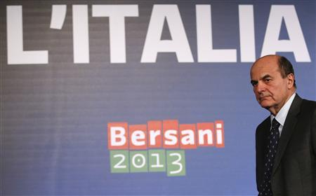 Italian PD (Democratic Party) leader Pier Luigi Bersani leaves at the end of a news conference in Rome February 26, 2013. Italy's stunned political parties looked for a way forward on Tuesday after an election that gave none of them a parliamentary majority, posing the threat of prolonged instability and European financial crisis. The results, notably by the dramatic surge of the anti-establishment 5-Star Movement of comic Beppe Grillo, left the centre-left bloc with a majority in the lower house but without the numbers to control the powerful upper chamber, the Senate. REUTERS/Tony Gentile