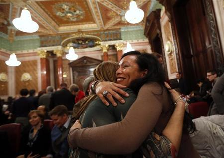 Mercedes Santos (R) hugs her partner of 21 years, Theresa Volpe, after a vote in a Committee hearing at the Illinois State Capital in Springfield, Illinois, January 3, 2013. REUTERS/Jim Young