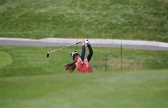 Ai Miyazato of Japan hits along the fourth fairway during the ProAm at the LPGA Canadian Women's Open golf tournament in Coquitlam, British Columbia August 22, 2012. REUTERS/Andy Clark