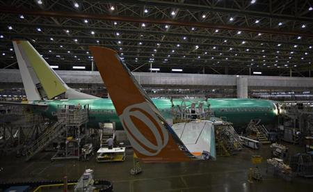 A Boeing 737-900 sits on the assembly line at the company's operations in Renton, Washington, October 18, 2012. REUTERS/Andy Clark/Files