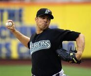 Florida Marlins starting pitcher Javier Vazquez throws a pitch to the New York Mets in the first inning of their MLB National League baseball game at CitiField in New York, in this file photo taken August 1, 2011. REUTERS/Ray Stubblebine