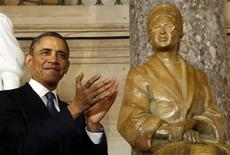 U.S. President Barack Obama applauds during the unveiling ceremony for the Rosa Parks statue in the U.S. Capitol in Washington February 27, 2013. REUTERS/Kevin Lamarque