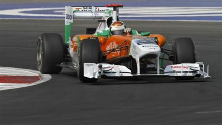 Force India Formula One driver Adrian Sutil of Germany takes a turn during the third practice session for Indian first F1 Grand Prix at the Buddh International Circuit in Greater Noida on the outskirts of New Delhi October 29, 2011. REUTERS/Altaf Hussain