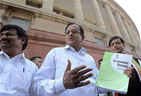Finance Minister Palaniappan Chidambaram holds the economic survey 2012-13 report at parliament in New Delhi February 27, 2013. REUTERS/B Mathur