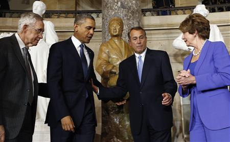 (From L-R) Senate Majority Leader Harry Reid, U.S. President Barack Obama, House Speaker John Boehner and House Minority Leader Nancy Pelosi attend the unveiling ceremony for the Rosa Parks statue in the U.S. Capitol in Washington February 27, 2013. REUTERS/Kevin Lamarque