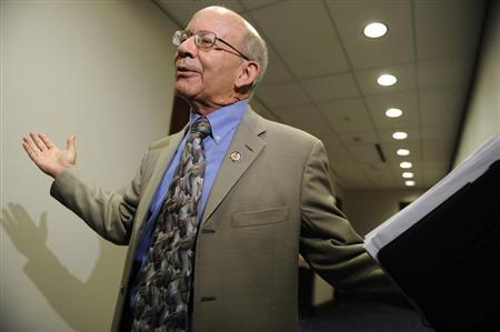 U.S. Representative Peter DeFazio (D-OR) throws up his hands as he talks to reporters after a Democratic caucus meeting about debt relief legislation with U.S. Vice President Joe Biden at the U.S. Capitol in Washington August 1, 2011. REUTERS/Jonathan Ernst