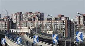 Apartments are seen from a street in Beijing February 27, 2013. REUTERS/Kim Kyung-Hoon