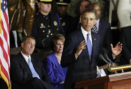 U.S. House Speaker John Boehner (L) and House Minority Leader Nancy Pelosi (D-CA) listen to U.S. President Barack Obama as he delivers remarks during the unveiling of a statue in honor of civil rights activist Rosa Parks, in Statuary Hall in the U.S. Capitol in Washington, February 27, 2013. REUTERS/Jason Reed