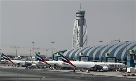 The traffic control tower is seen near the Emirates Terminal at Dubai International Airport, February 10, 2013. REUTERS/Jumana El Heloueh