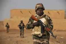 Soldiers from Niger patrol in an open field in Gao, February 27, 2013. REUTERS/Joe Penney