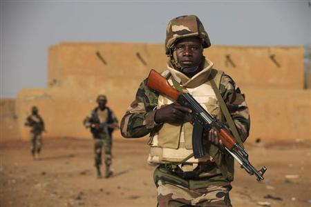 Soldiers from Niger patrol in an open field in Gao, February 27, 2013. REUTERS/Joe Penney