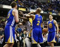 Indiana Pacers center Roy Hibbert (2nd L) shoves Golden State Warriors forward David Lee (L) while Warriors guards Jarrett Jack (2) and Klay Thompson (R) stand near the play during their NBA basketball game in Indianapolis, Indiana February 26, 2013. REUTERS/Brent Smith