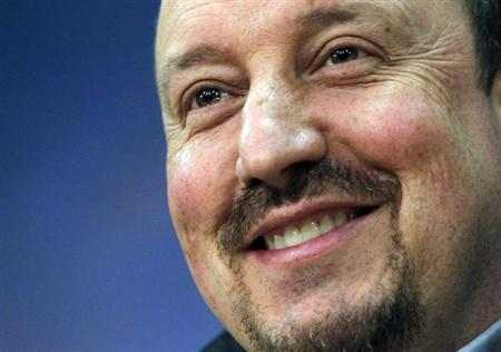 Chelsea's interim manager Rafael Benitez smiles during a news conference in Prague February 13, 2013. REUTERS/David W Cerny