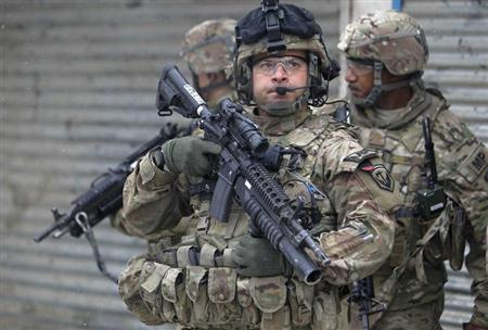 U.S. troops with the International Security Assistance Force (ISAF) keep watch at the site of a suicide attack in Kabul, February 27, 2013. REUTERS/Omar Sobhani