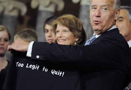U.S. Senator Lisa Murkowski (R-AK) (C) hands Vice President Joe Biden (2nd R) one of her campaign t-shirts after the ceremonial re-enactment of her swearing-in in the Old Senate Chamber at the U.S. Capitol in Washington, January 5, 2011. REUTERS/Jonathan Ernst