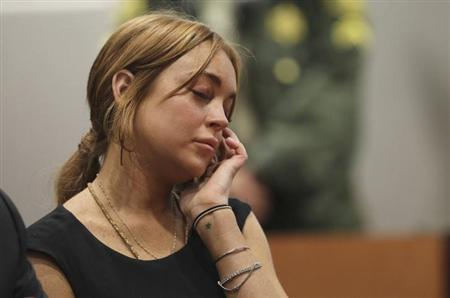Actress Lindsay Lohan attends a probation violation hearing at Airport Branch Courthouse in Los Angeles, California January 30, 2013. REUTERS/David McNew/Pool/Files