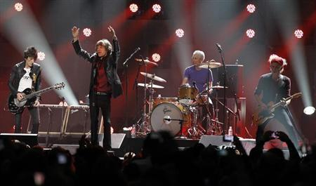 Ron Wood (L), Mick Jagger (2nd L), Charlie Watts and Keith Richards (R) of the Rolling Stones perform during the ''12-12-12'' benefit concert for victims of Superstorm Sandy at Madison Square Garden in New York December 12, 2012. REUTERS/Lucas Jackson
