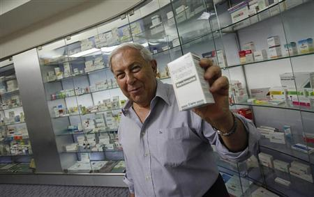 Y.K. Hamied, chairman and managing director of Indian generic drugmaker Cipla, poses for a picture in front of a cabinet containing the company's products before an interview in Mumbai May 8, 2012. REUTERS/Vivek Prakash