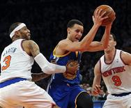 Golden State Warriors guard Stephen Curry (C) drives between New York Knicks forward Kenyon Martin (3) and guard Pablo Prigioni (9) in the second quarter of their NBA basketball game at Madison Square Garden in New York, February 27, 2013. REUTERS/Ray Stubblebine