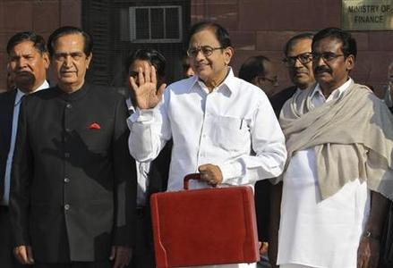 Finance Minister Palaniappan Chidambaram (C) poses as he leaves his office to present the 2013/14 budget in New Delhi February 28, 2013. REUTERS/B Mathur/Files