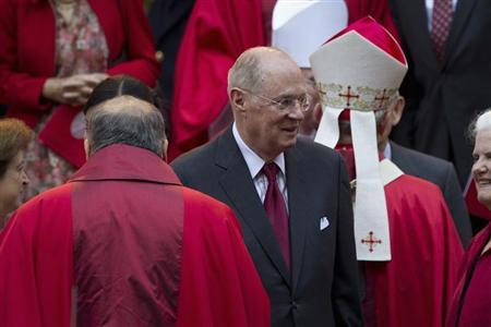 Supreme Court Justice Anthony Kennedy (C) leaves at the conclusion of the annual Red Mass held at the Cathedral of St. Matthew the Apostle in Washington, September 30, 2012. REUTERS/Benjamin Myers