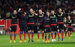 L'Atletico Madrid a rejoint mercredi le Real Madrid en finale de la Coupe du Roi à l'issue d'un match nul 2-2 sur la pelouse du FC Séville, qu'il avait battu 2-1 au match aller. /Photo prise le 27 février 2013/REUTERS/Marcelo del Pozo