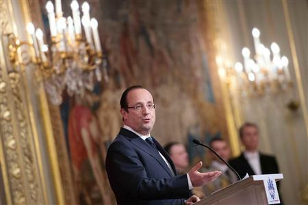 France's President Francois Hollande delivers his speech during an awards ceremony at the Elysee Palace in Paris, February 26, 2013. REUTERS/Bertrand Langlois/Pool