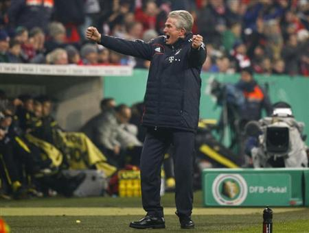 Bayern Munich's coach Jupp Heynckes celebrates his team's 1-0 victory over Borussia Dortmund following their German cup, DFB Pokal, quarter final match in Munich February 27, 2013. REUTERS/Michaela Rehle