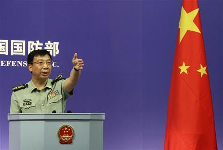 Spokesman of China's Defense Ministry Geng Yansheng gestures to a journalist after his speech during a news conference in Beijing July 27, 2011. REUTERS/China Daily