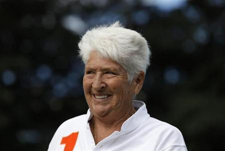 Former Australian swimmer Dawn Fraser smiles during a Reuters interview in Sydney April 7, 2011. REUTERS/Daniel Munoz/Files