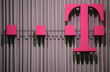 The logo of German company Deutsche Telekom is pictured at the CeBit computer fair in this file photo taken in Hanover, March, 6, 2012. Deutsche Telekom's operating profit dropped 13 percent in the fourth quarter as the company faced head-winds in its German mobile market and the rest of Europe. REUTERS/Fabian Bimmer/Files