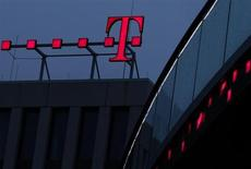 The logo of Deutsche Telekom AG is pictured at their headquarters, in this file photo taken in Bonn December 5, 2012. (GERMANY - Tags: BUSINESS TELECOMS) - RTR3EDQP
