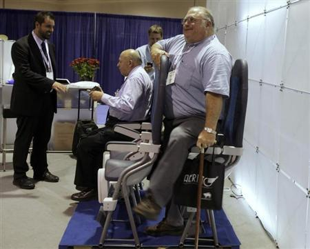A man tries out Italian company Aviointeriors' aircraft 'standing seat' which has 23 inches of legroom, instead of the current economy class average of 30 inches, at the Aircraft Interiors Expo in Long Beach, California, September 15, 2010. REUTERS/Lucy Nicholson