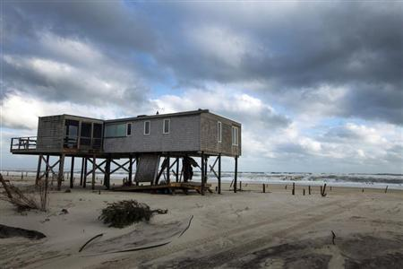 A home stands on stilts that once had sand piled to just below the floorboards after being struck by Hurricane Sandy in the community of Atlantique on Fire Island, New York October 30, 2012. REUTERS/Lucas Jackson