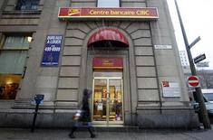 A pedestrian walks past a CIBC branch in Montreal, February 25, 2010. REUTERS/Christinne Muschi