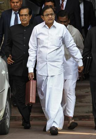Finance Minister Palaniappan Chidambaram walks as he leaves his office to present the 2013/14 budget in New Delhi February 28, 2013. REUTERS/B Mathur