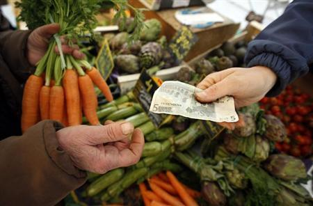 A shopper buys vegetables on a market in Nice southern France, February 28, 2008. REUTERS/Eric Gaillard