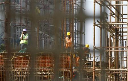 Labourers work at the construction site of a commercial complex in Chennai February 21, 2013. REUTERS/Babu/Files