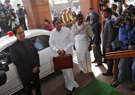 India's Finance Minister Palaniappan Chidambaram (C) arrives at the parliament to present the 2013/14 federal budget in New Delhi February 28, 2013. Chidambaram will present one of the most highly anticipated budgets of recent years, a blueprint for austerity that forms the centrepiece of India's efforts to stave off a ratings downgrade. Investors will watch closely to see whether he will fulfil his promise of fiscal prudence. REUTERS/Adnan Abidi