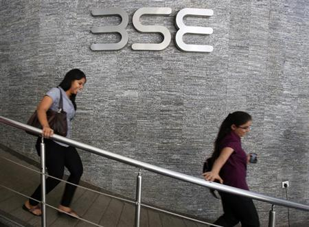 Employees walk in a lobby at the Bombay Stock Exchange (BSE) during the announcement of the annual budget in Mumbai February 28, 2013. REUTERS/Vivek Prakash