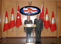 Turkey's newly appointed Land Forces Commander and acting deputy Chief of General Staff Necdet Ozel (R) poses with outgoing Land Forces Commander General Erdal Ceylanoglu during a handover ceremony at the Land Forces headquarters in Ankara July 30, 2011. REUTERS/Turkey Land Forces Headquarters/Handout