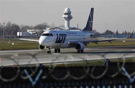 A Polish airline LOT airplane Embraer 170 taxis on the runway at Chopin airport in Warsaw, December 6, 2012. REUTERS/Kacper Pempel