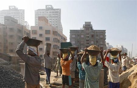 Labourers work at the construction site of a residential complex in Kolkata February 22, 2013. REUTERS/Rupak De Chowdhuri