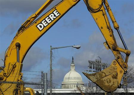 A back loader bucket is seen near the U.S. Capitol in Washington February 27, 2013. REUTERS/Gary Cameron