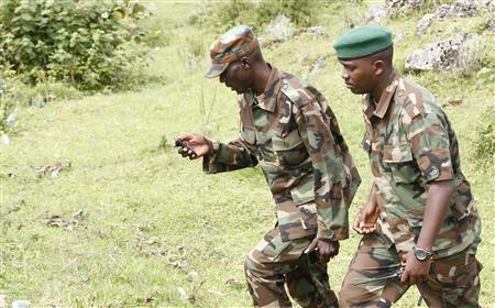 M23 military leader General Sultani Makenga (L) arrives to attend a news conference in Bunagana in eastern Democratic Republic of Congo January 3, 2013. REUTERS/James Akena