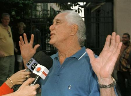 ''Great Train'' robber Ronald Biggs celebrates outside his home in Rio de Janeiro in this file photo from November 12, 1997 after the Supreme Court rejected a British request for his extradition.