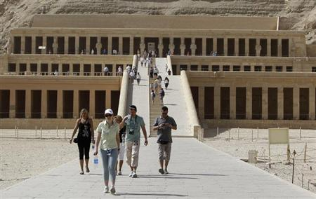 Tourists walk along the main corridor of the Temple of Hatshepsut, a day after a hot air balloon crash left 19 foreigners dead, in Luxor, February 27, 2013. REUTERS/Mohamed Abd El Ghany