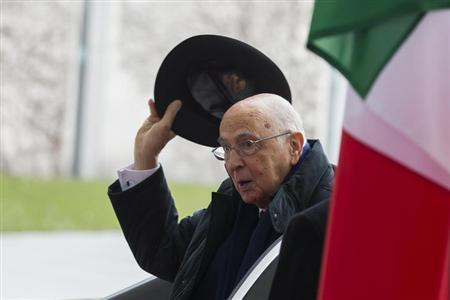 Italian President Giorgio Napolitano lifts his hat as he meets with German Chancellor Angela Merkel (not pictured) for talks at the Chancellery in Berlin February 28, 2013. REUTERS/Thomas Peter (GERMANY - Tags: POLITICS)