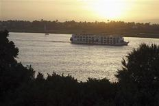 A Nile Cruise boat sails along the Nile River, a day after a hot air balloon crash left 19 foreigners dead, in Luxor February 27, 2013. REUTERS/Mohamed Abd El Ghany