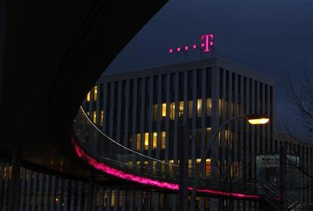 The headquarters of Deutsche Telekom AG in is pictured in this file photo taken in Bonn December 5, 2012. Deutsche Telekom's operating profit dropped 13 percent in the fourth quarter as the company faced head-winds in its German mobile market and the rest of Europe. REUTERS/Ina Fassbender/Files (GERMANY - Tags: BUSINESS TELECOMS)